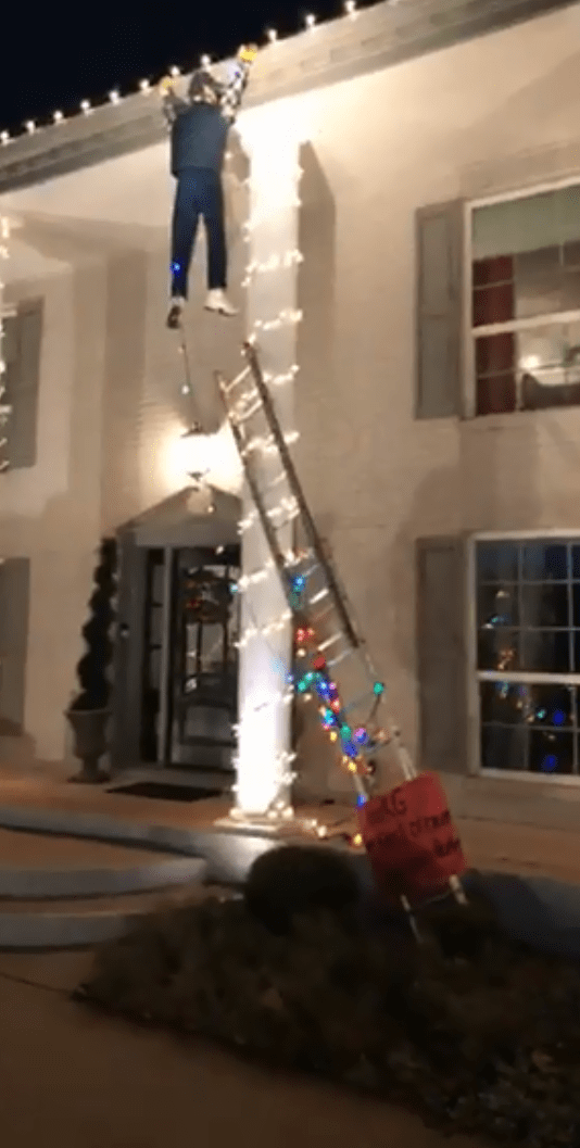 Christmas decoration of 'man' hanging off roof makes walker dial 911