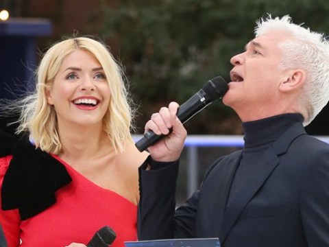 Holly Willoughby looks thrilled as she reunites with Philip Schofield at Dancing on Ice launch