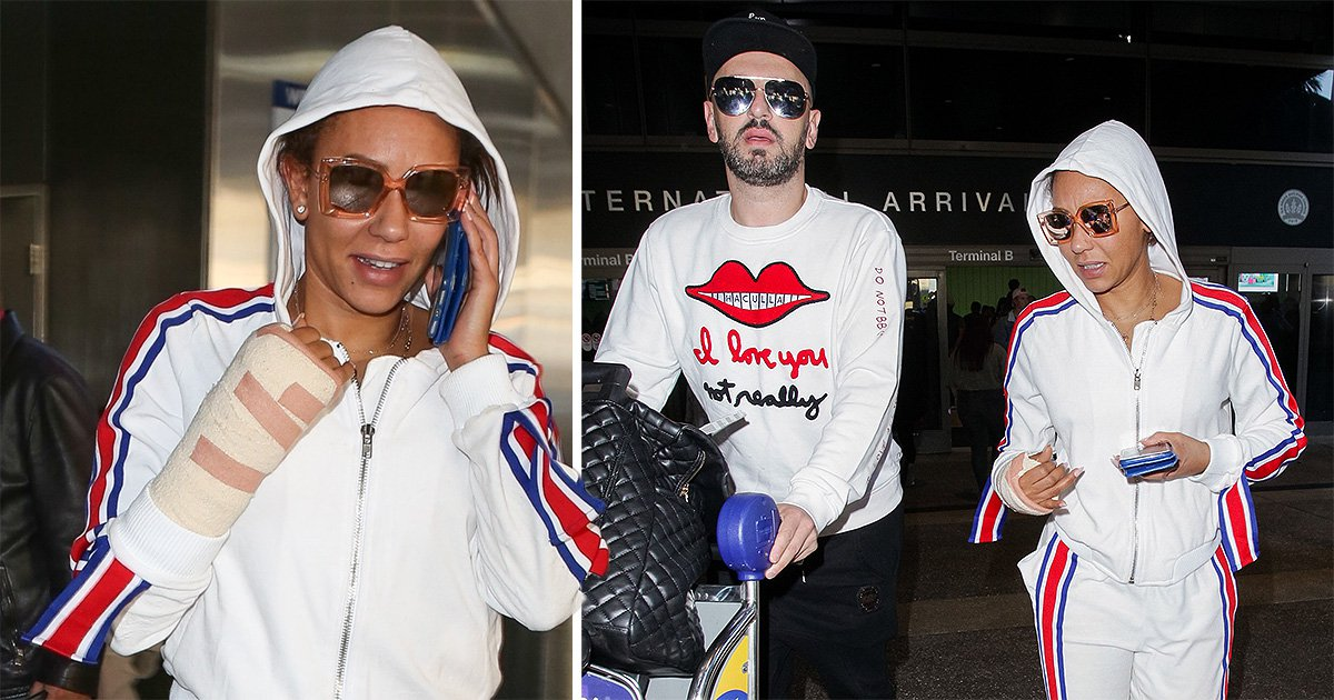 Mel B's hand still heavily bandaged as she touches down in LA after 'severing' it in horrific accident
