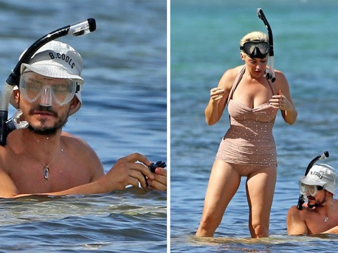 Orlando Bloom covers up more than he did paddleboarding as he snorkels with Katy Perry