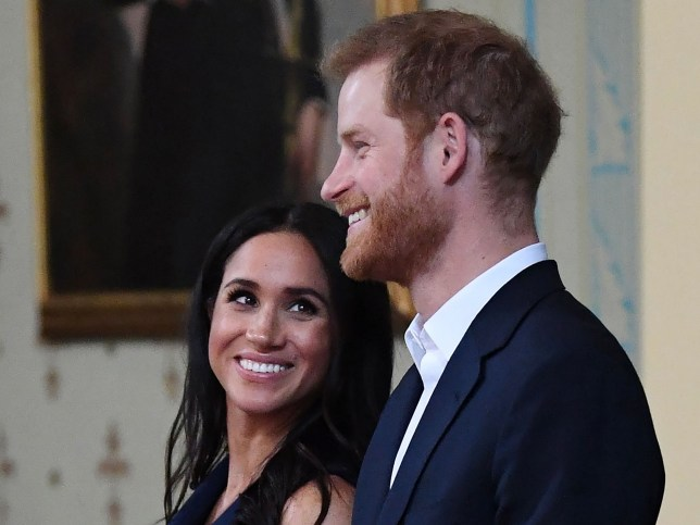 (FILES) In this file photo taken on October 18, 2018 Britain's Prince Harry and Meghan, Duchess of Sussex attend a reception at Government House in Melbourne, Australia. - Prince Harry and his pregnant wife Meghan Markle will move into a historic cottage on the royal family's Windsor Estate early next year, Kensington Palace said on Saturday, November 24, 2018. (Photo by JULIAN SMITH / POOL / AFP)JULIAN SMITH/AFP/Getty Images