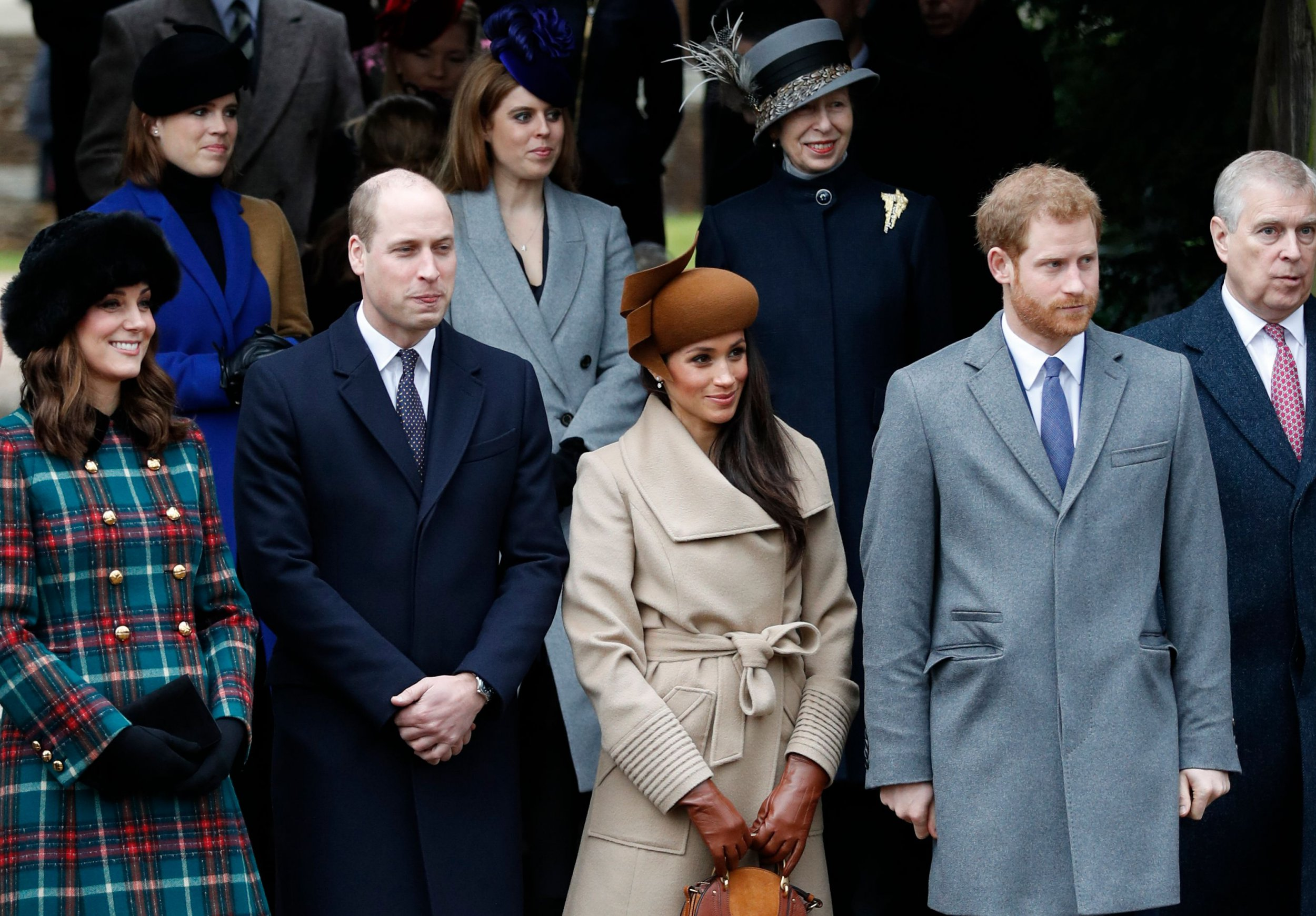 Britain's Catherine, Duchess of Cambridge, (L) and Britain's Prince William, Duke of Cambridge, (2L), US actress and fiancee of Britain's Prince Harry Meghan Markle (2R) and Britain's Prince Harry (R) stand together as they wait to see off Britain's Queen Elizabeth II after attending the Royal Family's traditional Christmas Day church service at St Mary Magdalene Church in Sandringham, Norfolk, eastern England, on December 25, 2017. / AFP PHOTO / Adrian DENNIS (Photo credit should read ADRIAN DENNIS/AFP/Getty Images)