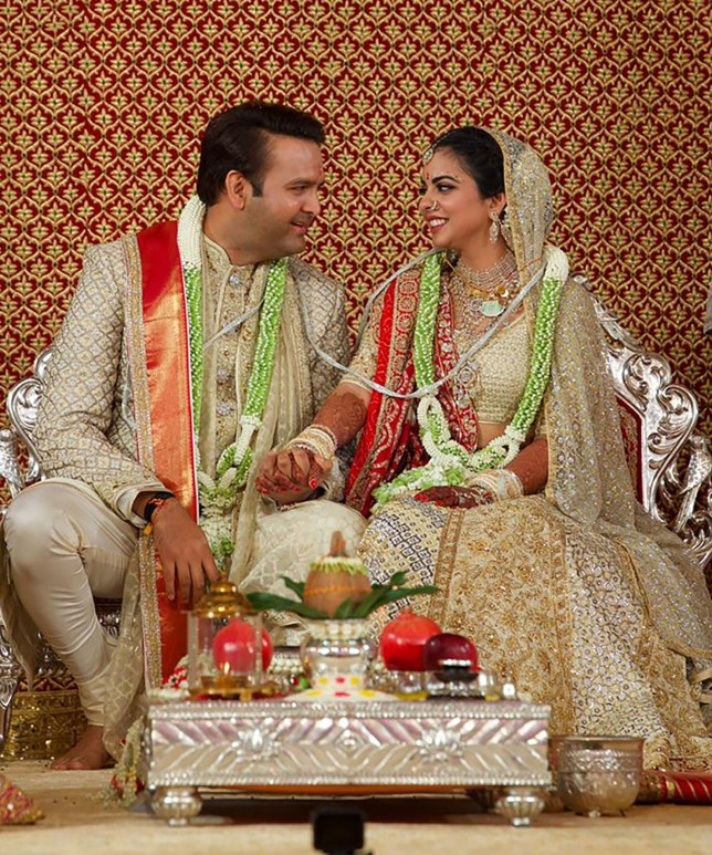 """This handout photograph taken on December 12, 2018 and released on December 13 by Reliance Industries shows Reliance Industries chairman Mukesh Ambani's daughter Isha Ambani (L) taking part in traditional marriage ritual with Indian businessman Ajay Piramal's son, Anand Piramal in Mumbai. (Photo by Handout / Reliance Industries / AFP) / RESTRICTED TO EDITORIAL USE - MANDATORY CREDIT """"AFP PHOTO / RELIANCE INDUSTRIES"""" - NO MARKETING NO ADVERTISING CAMPAIGNS - DISTRIBUTED AS A SERVICE TO CLIENTS --- NO ARCHIVE ---HANDOUT/AFP/Getty Images"""