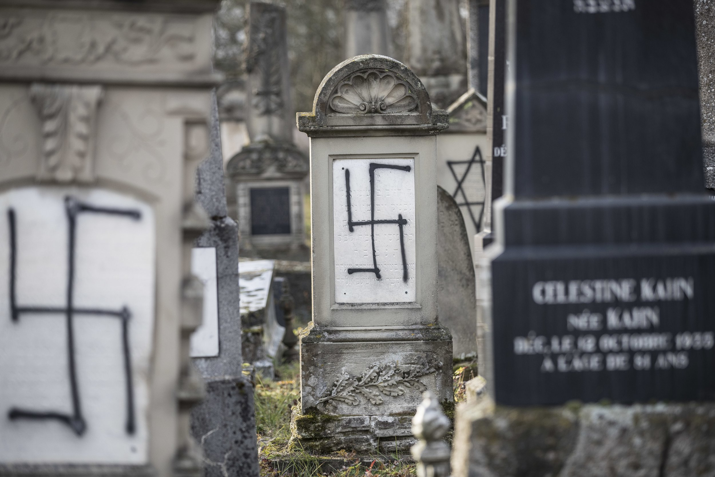 Jewish tombstones are desecrated with swastikas in the Herrlisheim Jewish cemetery, north of Strasbourg, eastern France, Thursday, Dec. 13, 2018. Dozens of tombs were defaced and discovered Tuesday. (AP Photo/Jean-Francois Badias)