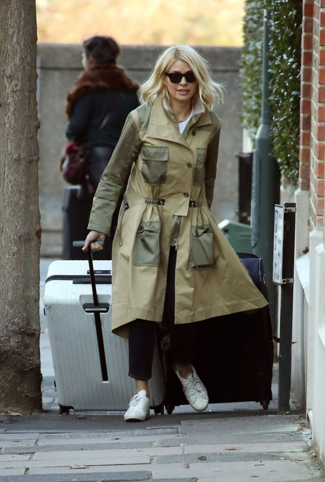 BGUK_1433949 - London, UNITED KINGDOM - Fresh from her stint in Australia on 'I'm a Celebrity', the tv presenter Holly Willoughby returns home from gruelling long journey. Holly looked stylish in her quirky two toned beige coat and looked fresh faced upon her arrival. Perhaps forking out for a private suite on board the Etihad Airlines plane which cost a whopping ??19,000 that's been dubbed 'a penthouse in the sky' helped. Pictured: Holly Willoughby BACKGRID UK 13 DECEMBER 2018 UK: +44 208 344 2007 / uksales@backgrid.com USA: +1 310 798 9111 / usasales@backgrid.com *UK Clients - Pictures Containing Children Please Pixelate Face Prior To Publication*