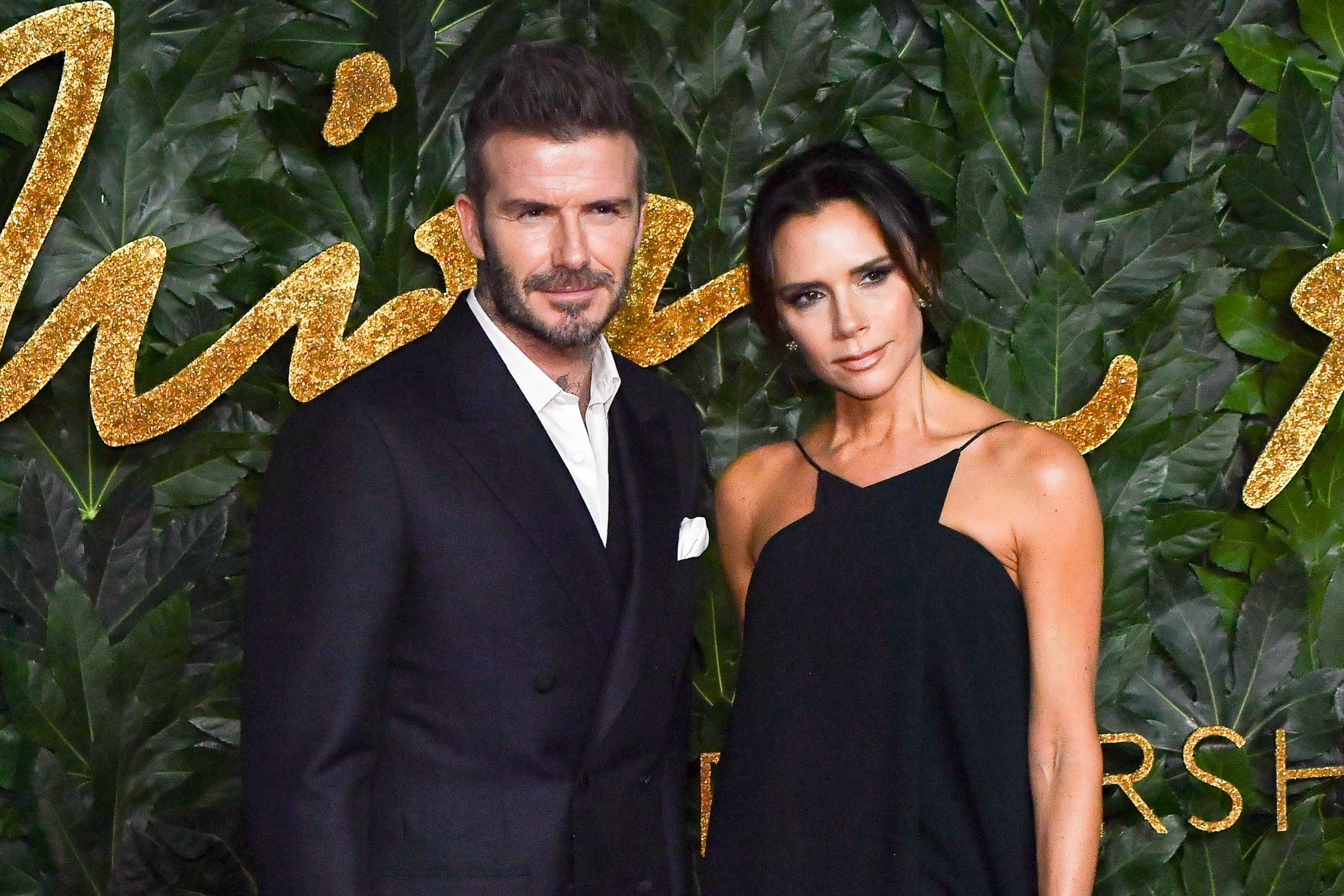 LONDON, ENGLAND - DECEMBER 10: David Beckham and Victoria Beckham attend the Fashion Awards 2018 in partnership with Swarovski at Royal Albert Hall on December 10, 2018 in London, England. (Photo by Stephane Cardinale - Corbis/Corbis via Getty Images)