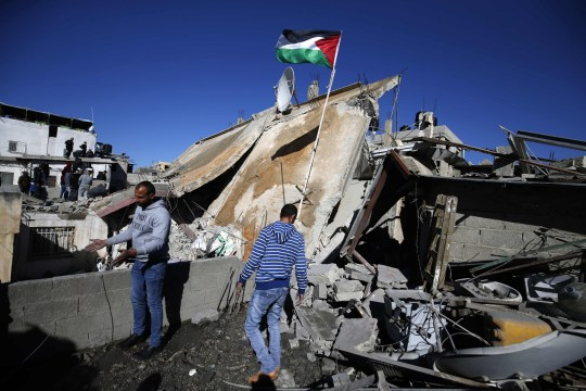 People gather at the scene where the house belonging to a Palestinian accused of killing an Israeli soldier a few months ago was blown up by Israeli troops in Ramallah in the Israeli-occupied West Bank on December 15, 2018. - Israeli Sergeant Ronen Lubarsky, 20, of the Duvdevan special forces unit, reportedly died on May 26, 2018, two days after being struck on the head by a stone block thrown during an arrest raid. Israeli media said that the block was a granite slab dropped from a third-floor window. (Photo by ABBAS MOMANI / AFP)ABBAS MOMANI/AFP/Getty Images