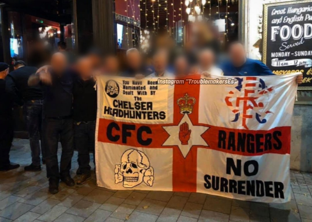 Chelsea fans are pictured with hooligan flag bearing 'SS death's head' Nazi symbol before controversial Budapest match where supporters chanted antisemitic songs