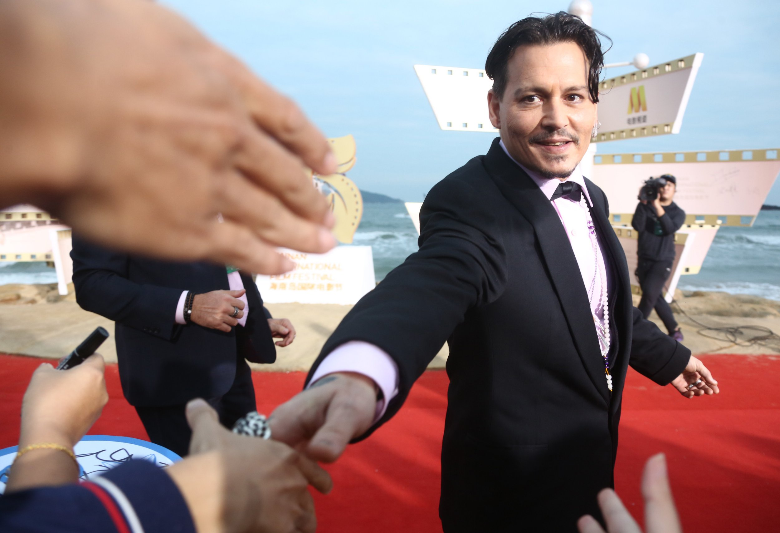 Johnny Depp looks sharp as he closes Hainan International Film Festival