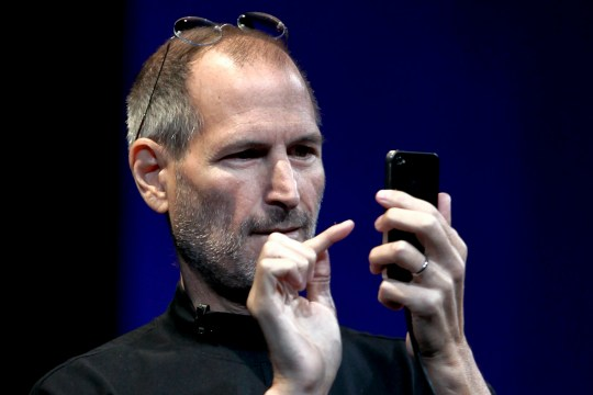 FILE PHOTO: Steve Jobs, chief executive officer of Apple Inc., demonstrates the gyroscope functionality on the iPhone 4 during his keynote address at the Apple Worldwide Developers Conference (WWDC) in San Francisco, California, U.S., on Monday, June 7, 2010. Apple Inc. Chief Executive Officer Steve Jobs, who built the world???s most valuable technology company, resigned. He is succeeded by Chief Operating Officer Tim Cook. Photographer: David Paul Morris/Bloomberg via Getty Images