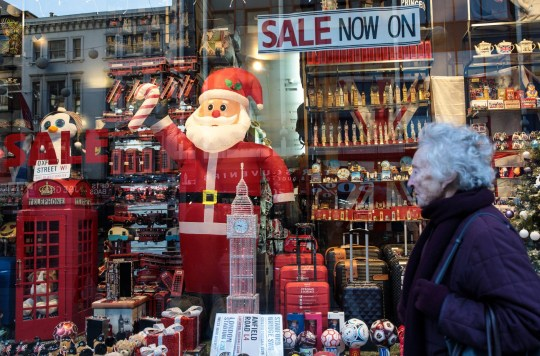 LONDON, ENGLAND - DECEMBER 17: People walk past a Christmas window display on Oxford Street on December 17, 2018 in London, England. Fewer shoppers are hitting the High Street in the run-up to Christmas, turning instead to online shopping according to figures released by retail intelligence firm Springboard. (Photo by Jack Taylor/Getty Images)