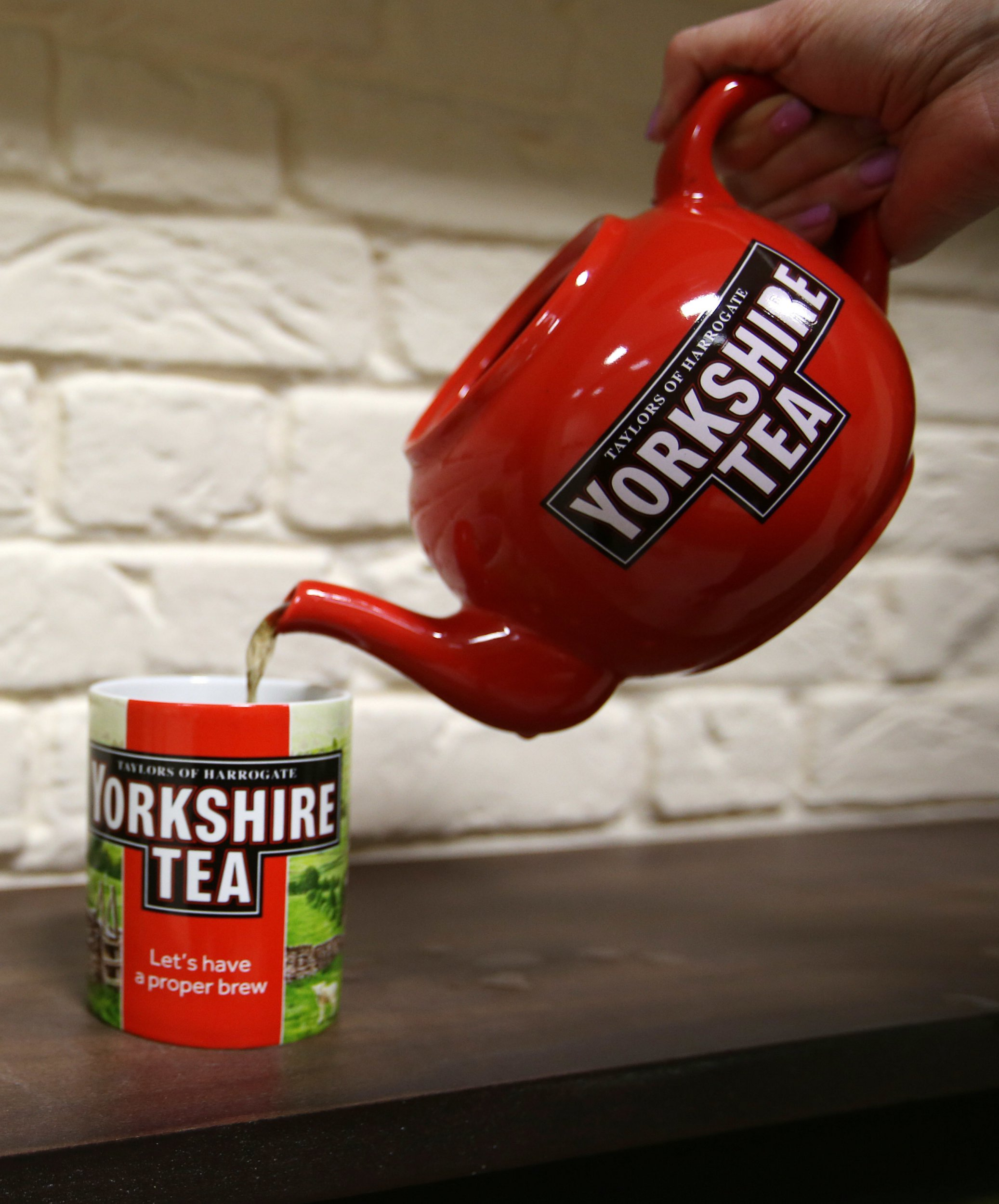 File photo dated 06/05/15 of a cup of Yorkshire Tea being poured from a teapot. The brand's new biodegradable tea bags have left customers stewing - after they complained the flimsy bags were ruining their cuppas. PRESS ASSOCIATION Photo. Issue date: Tuesday December 18, 2018. Tea lovers contacted the company in despair, reporting that the once-reliable tea bags were splitting in their brews.See PA story CONSUMER YorkshireTea. Photo credit should read: Lynne Cameron/PA Wire