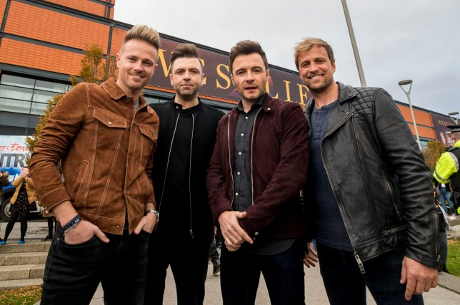 (left to right) Nicky Byrne, Markus Feehily, Shane Filan, and Kian Egan of Westlife, outside the SSE Arena, Belfast, ahead of the press conference for tickets going on sale for their reunion tour