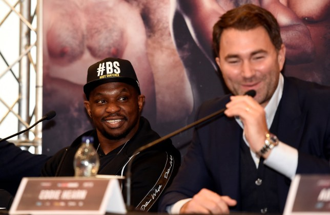 Boxing - Dillian Whyte & Dereck Chisora Press Conference - Canary Riverside Plaza Hotel, London, Britain - December 20, 2018 Dillian Whyte with promoter Eddie Hearn during the press conference Action Images via Reuters/Adam Holt