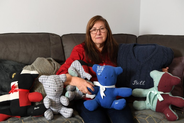 Seven children are getting a grandad's ashes inside a teddy bear for Christmas - to help them remember him for ever. Grieving grandmother Beryl John is keeping her husband Bill's memory alive by putting his ashes in the teddy bears for the family. Retired nurse Beryl, 65, was left heartbroken when husband Bill, 64, died of a heart attack earlier this year. Pictured here is Beryl with with some of the teddies and cushions made out of his clothes ?? WALES NEWS SERVICE
