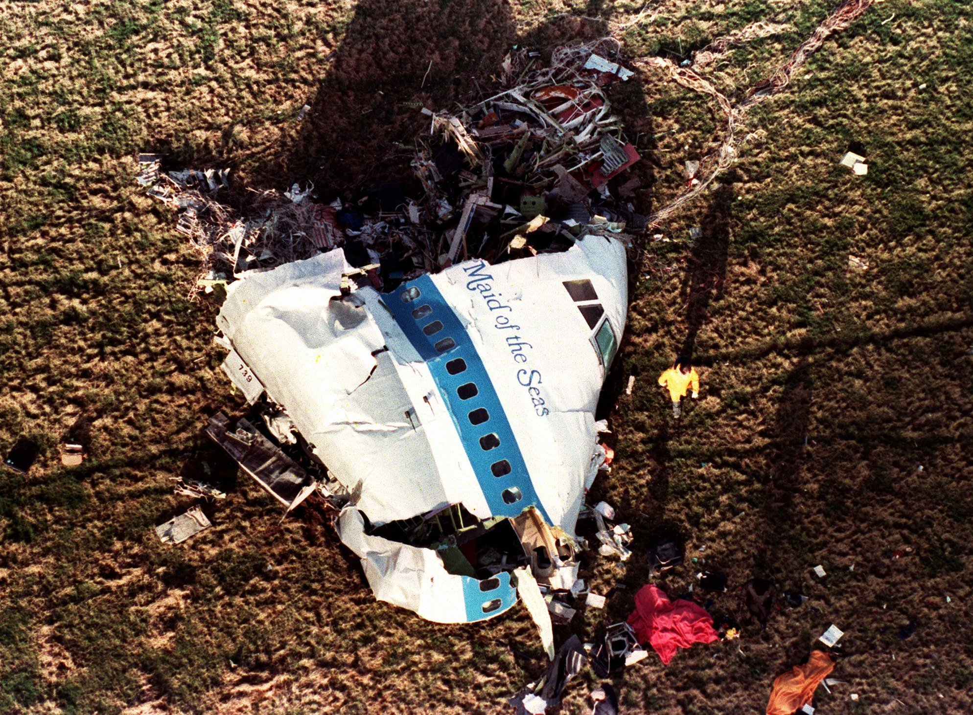 "FILE - In this Dec. 22, 1988 file photo the nose section of Pan Am Flight 103, a 747 airliner dubbed ""The Maid of the Sea,"" lies in a field outside the village of Lockerbie, Scotland. In 1988, 270 people were killed when a terrorist bomb exploded aboard a Pam Am Boeing 747 over Lockerbie, Scotland, sending wreckage crashing to the ground. (AP Photo/Martin Cleaver, File)"