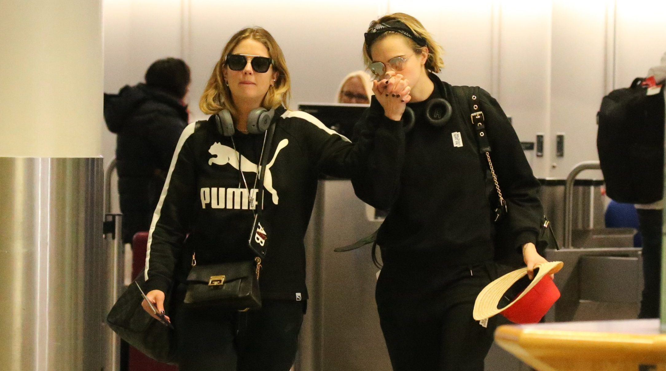 EXCLUSIVE: * Online Set Fee 250 GBP * * UK Print Min Set Fee 300 GBP - Double Fees Page 1 * Cara Delevingne and girlfriend Ashley Benson Seen Arriving At Gatwick Airport, as news was announced that all flights have been grounded yet again following further drone sightings. Cara & Ashley can be seen giving each other a high five, before reality sinks back in when their informed that they won't be boarding the plane anytime soon. It seems that Cara and Ashley have been forced to put their romantic Christmas getaway on hold for now. Pictured: Cara Delevingne,Ashley Benson Ref: SPL5051280 211218 EXCLUSIVE Picture by: SplashNews.com * Online Set Fee 250 GBP * * UK Print Min Set Fee 300 GBP - Double Fees Page 1 Splash News and Pictures Los Angeles: 310-821-2666 New York: 212-619-2666 London: 0207 644 7656 Milan: 02 4399 8577 photodesk@splashnews.com World Rights