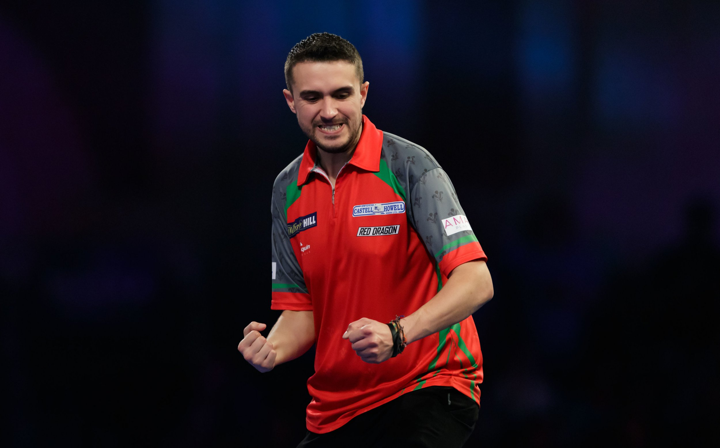 Jamie Lewis celebrates during his match against Daryl Gurney during day ten of the William Hill World Darts Championships at Alexandra Palace, London. PRESS ASSOCIATION Photo. Picture date: Saturday December 22, 2018. Photo credit should read: John Walton/PA Wire