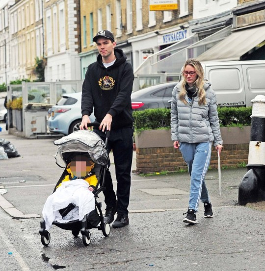 Nicholas Hoult seen for first time with baby son as he and
