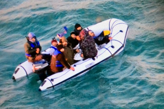 This image provided by the Marine Nationale (French Navy) shows migrants aboard a rubber boat after being intercepted by French authorities, off the port of Calais, northern France, Tuesday, Dec. 25, 2018. French authorities have rescued eight migrants, including two children, whose engine failed as they tried to sneak across the English Channel to Britain. (Marine Nationale via AP)