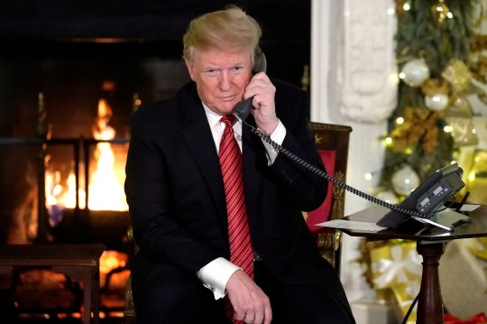 FILE PHOTO: U.S. President Donald Trump participates in NORAD Santa tracker phone calls from the White House in Washington, Dec. 24, 2018. REUTERS/Jonathan Ernst/File Photo