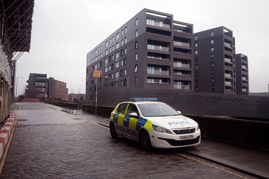Police pattrol the canal path tunnel under Redhill St in Ancoats on Boxing Day after a body was found Credit: MEN Media