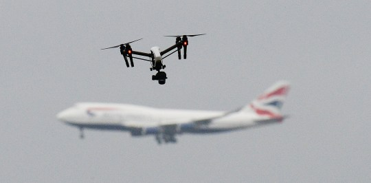 FILE PHOTO dated 25/2/2017 of a drone and an aircraft. Gatwick airport remains closed this morning after drones were spotted over the airfield last night and this morning.