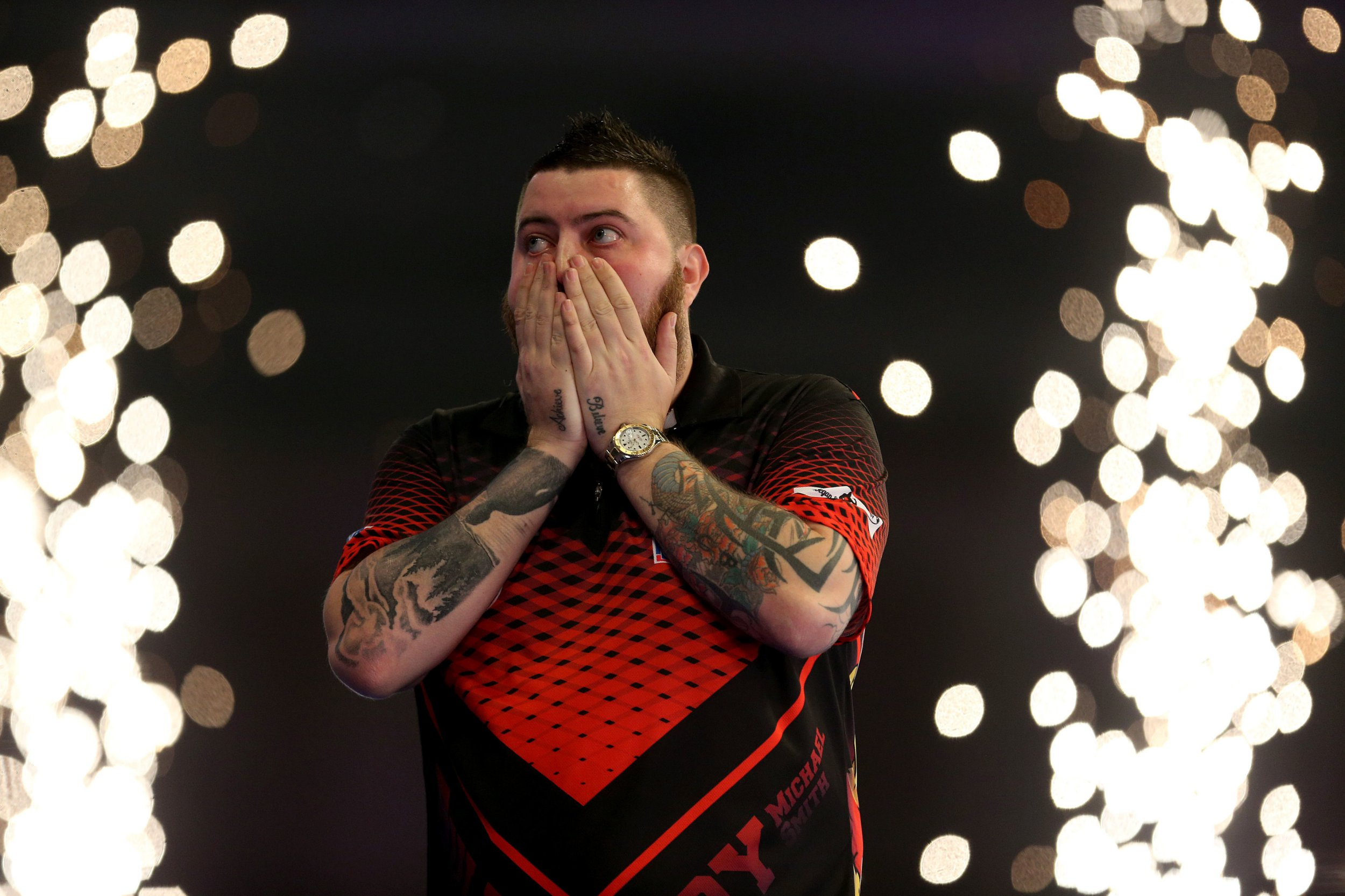 Michael Smith reacting after winning his match during day fifteen of the William Hill World Darts Championships at Alexandra Palace, London. PRESS ASSOCIATION Photo. Picture date: Sunday December 30, 2018. Photo credit should read: Steven Paston/PA Wire