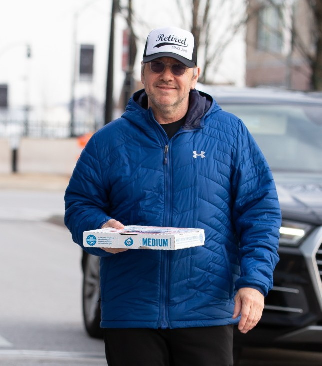 """EXCLUSIVE: ??500 Print / ??500 Online Scandal-hit Kevin Spacey went on a charm offensive with paparazzi gathered outside his Baltimore bolthole - bringing them pizza and wishing them a ???Happy New Year"""". Wearing a baseball hat that said ???Retired 2017???, the under-fire actor left his $6 million waterfront mansion and drove to a spot where photographers had been waiting in bitterly cold temperatures. Sporting a huge smile, he handed Domino???s 12 inch hand tossed cheese pizzas out to two lensmen and assured them he ???appreciates??? their efforts. He then added: ???Stay warm and have a Happy New Year??? and flashed a ???peace??? sign. The 59-year-old ignored a question about whether he planned to show up to his looming court appearance in Nantucket and jumped into his Audi SUV. He was then spotted generously giving cash to a panhandler as he waited in traffic. The festive gesture undoubtedly signals that the 'House of Cards' star, who has been out of the spotlight for over a year, is finished hiding - and judging by his hat he???s also done with showbiz. He is facing felony sexual assault allegations and is due to be arraigned on January 7. Pictured: kevin spacey Ref: SPL5052110 301218 EXCLUSIVE Picture by: Splash News / SplashNews.com Splash News and Pictures Los Angeles: 310-821-2666 New York: 212-619-2666 London: 0207 644 7656 Milan: 02 4399 8577 photodesk@splashnews.com World Rights"""