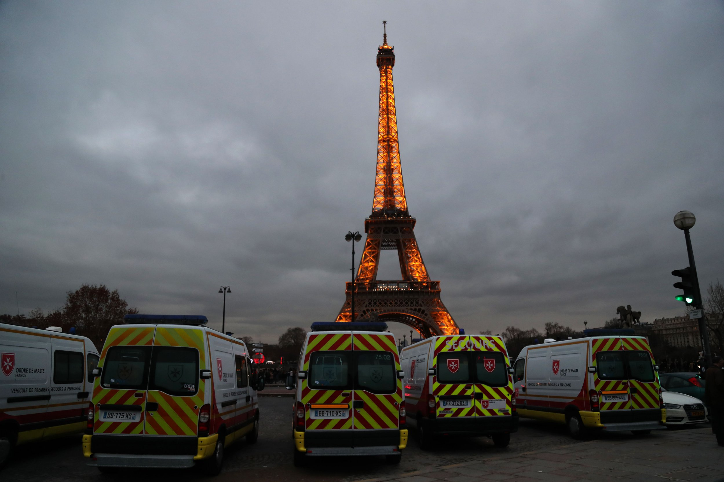 Emergency workers vehicles are parked at the Trocadero gardens with the Eiffel Tower in background, in Paris on December 31, 2018, ahead of the New Year's Eve celebrations. (Photo by Zakaria ABDELKAFI / AFP)ZAKARIA ABDELKAFI/AFP/Getty Images
