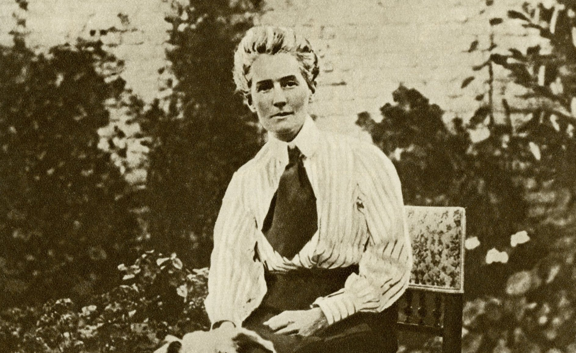 Edith Cavell (4 December 1865 ?? 12 October 1915), nurse during the First World War who saved the lives of soldiers in occupied Belgium, helping them escape across the border. Executed by the Germans for treason. Portrait taken before the war in her garden with her two dogs. (Photo by Culture Club/Getty Images)