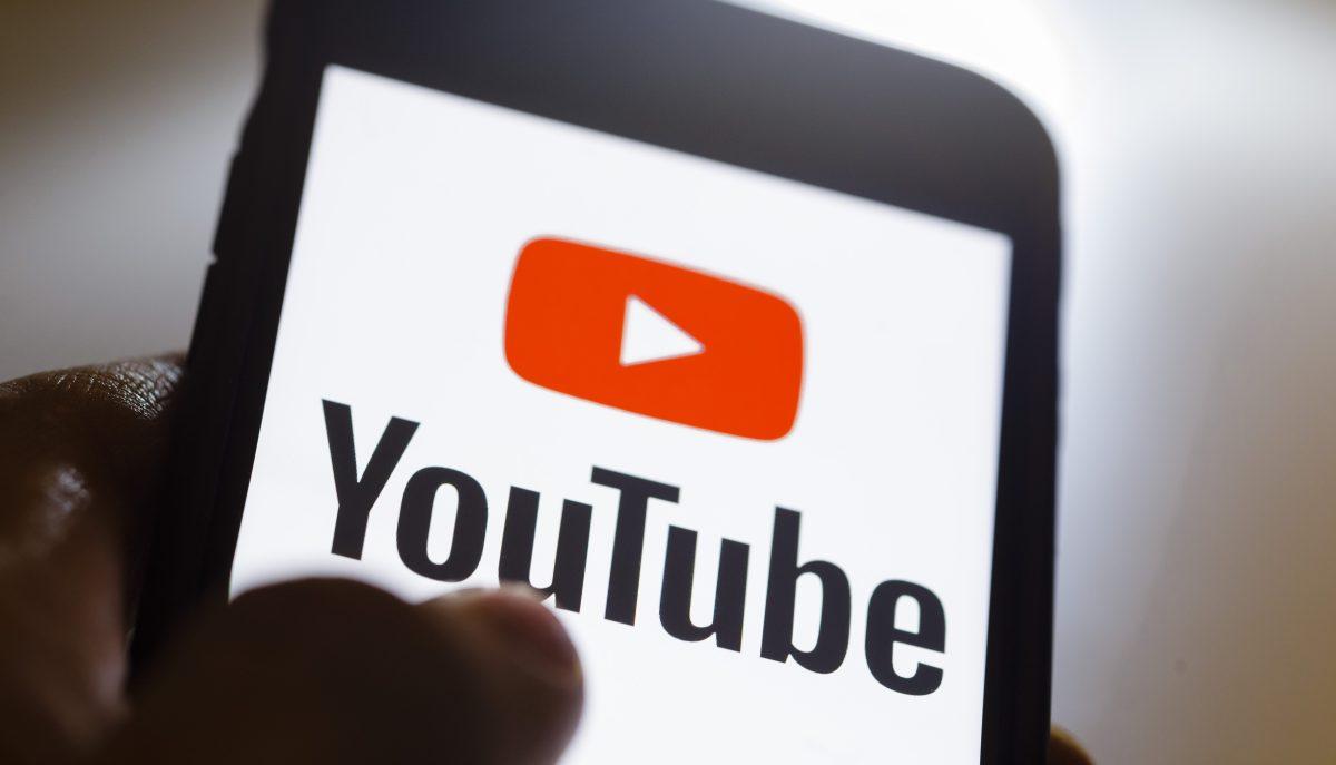 YouTube logo on a smartphone screen