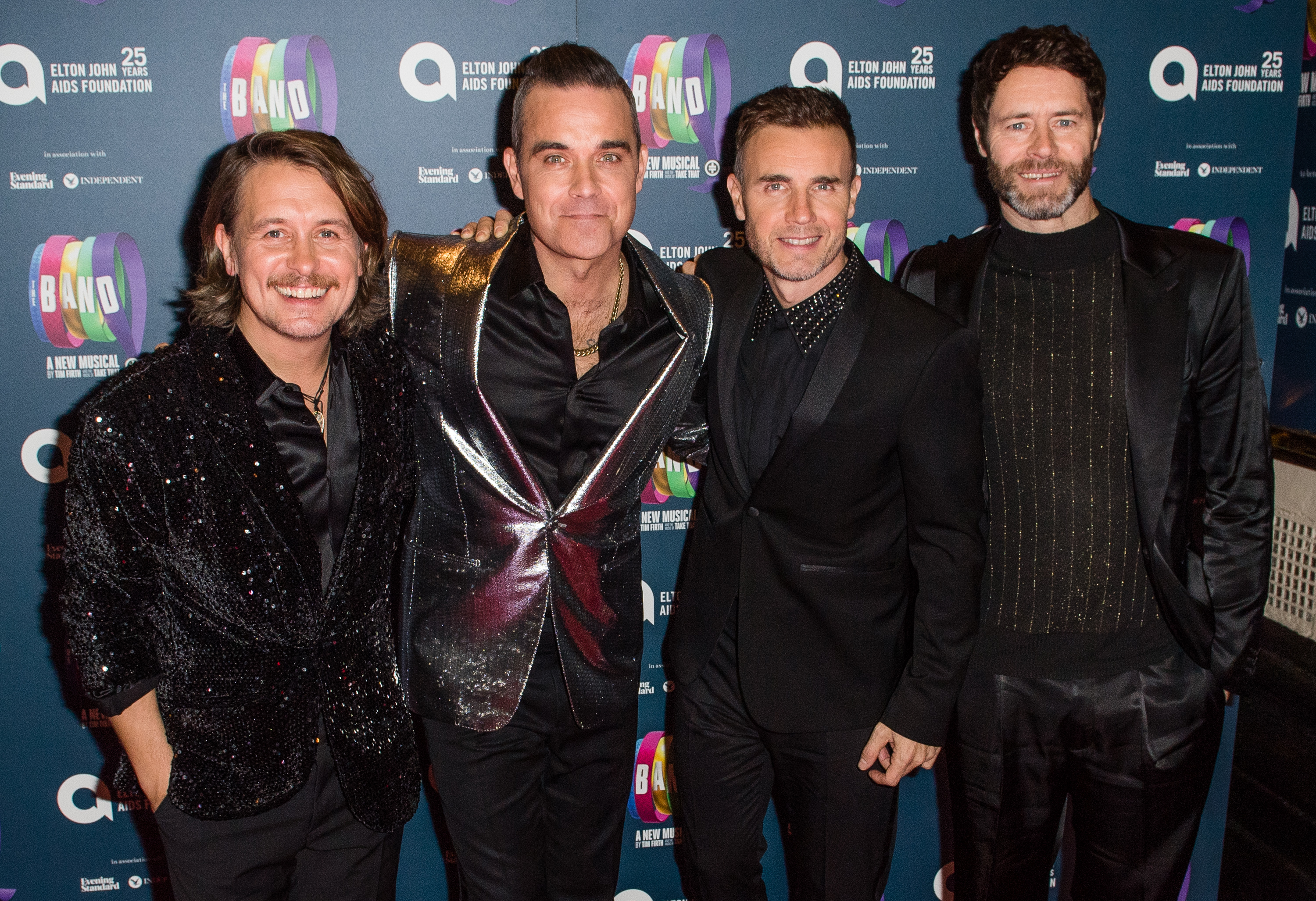 Robbie Williams teases Take That reunion on tour and we honestly can't cope