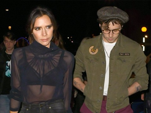 Victoria Beckham braves the cold in sheer blouse as David and Brooklyn bundle up on family night out