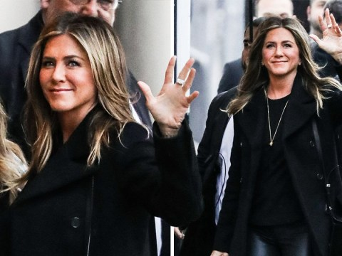 Jennifer Aniston is one happy customer as she waves her way along the street
