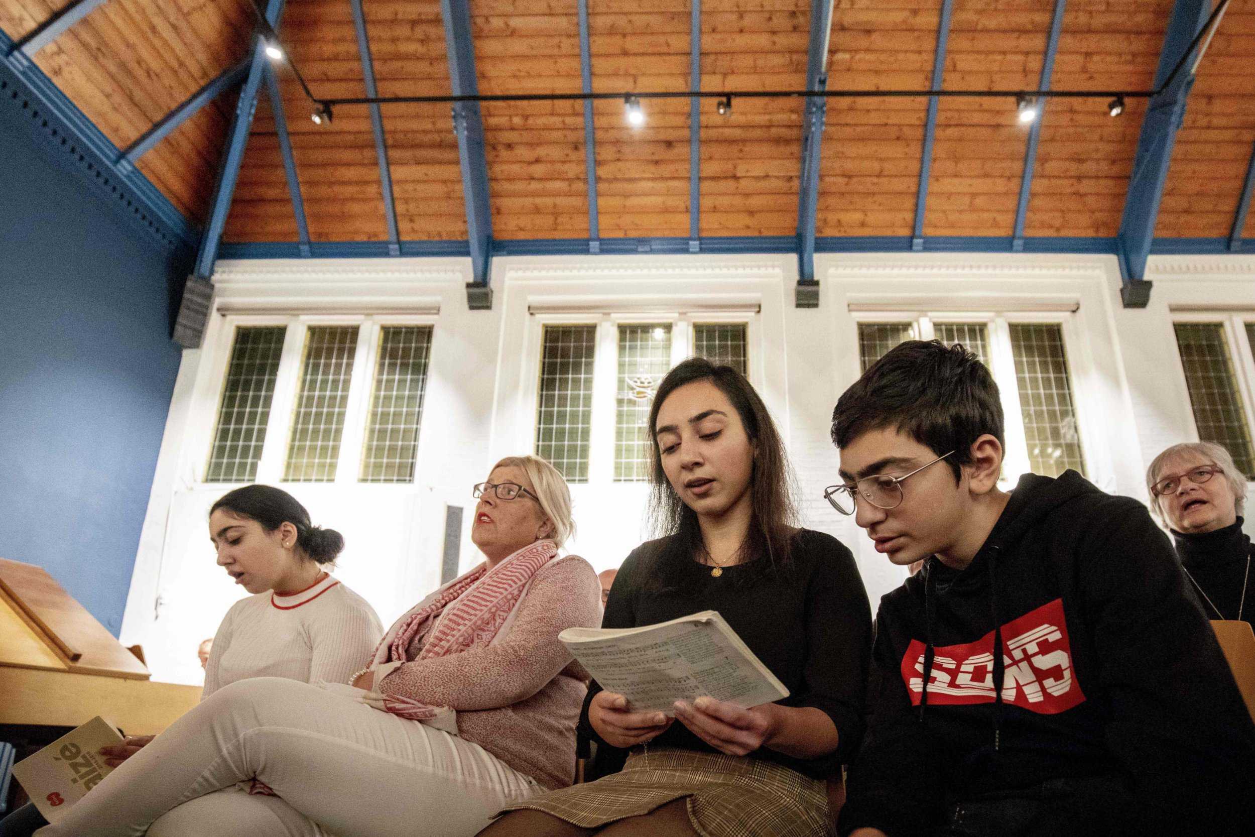 Armenian Hayarpi Tamrazyan (2ndR) and her brother Warduhi during a service in the Bethel church in The Hague, on October 30, 2018. - A Dutch church has resorted to the power of prayer to stop the deportation of an Armenian family sheltering there, holding round-the-clock religious services for more than a month to keep police at bay, officials said on November 30, 2018. The five members of the Tamrazyan family, who have been living in the Netherlands for nine years, took refuge in the church on October 25, 2018 after Dutch authorities turned down their request for asylum. (Photo by Niels Wenstedt / POOL / AFP) / Netherlands OUT - Belgium OUTNIELS WENSTEDT/AFP/Getty Images