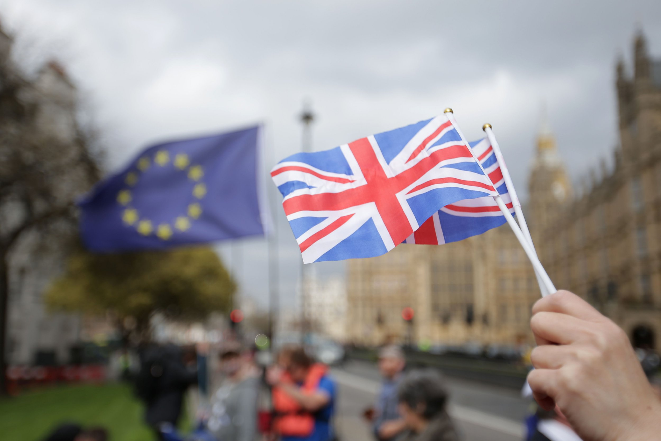 A person holds Union Flags near the Houses of Parliament in London, on March 29, 2017, after British Prime Minister Theresa May announced to the House of Commons that Article 50 of the Lisbon Treaty had been triggered, formally starting Britain's withdrawl from the European Union (EU). Britain formally launched the process for leaving the European Union on March 29, a historic move that has split the country and thrown into question the future of the European project. / AFP PHOTO / Daniel LEAL-OLIVAS (Photo credit should read DANIEL LEAL-OLIVAS/AFP/Getty Images)