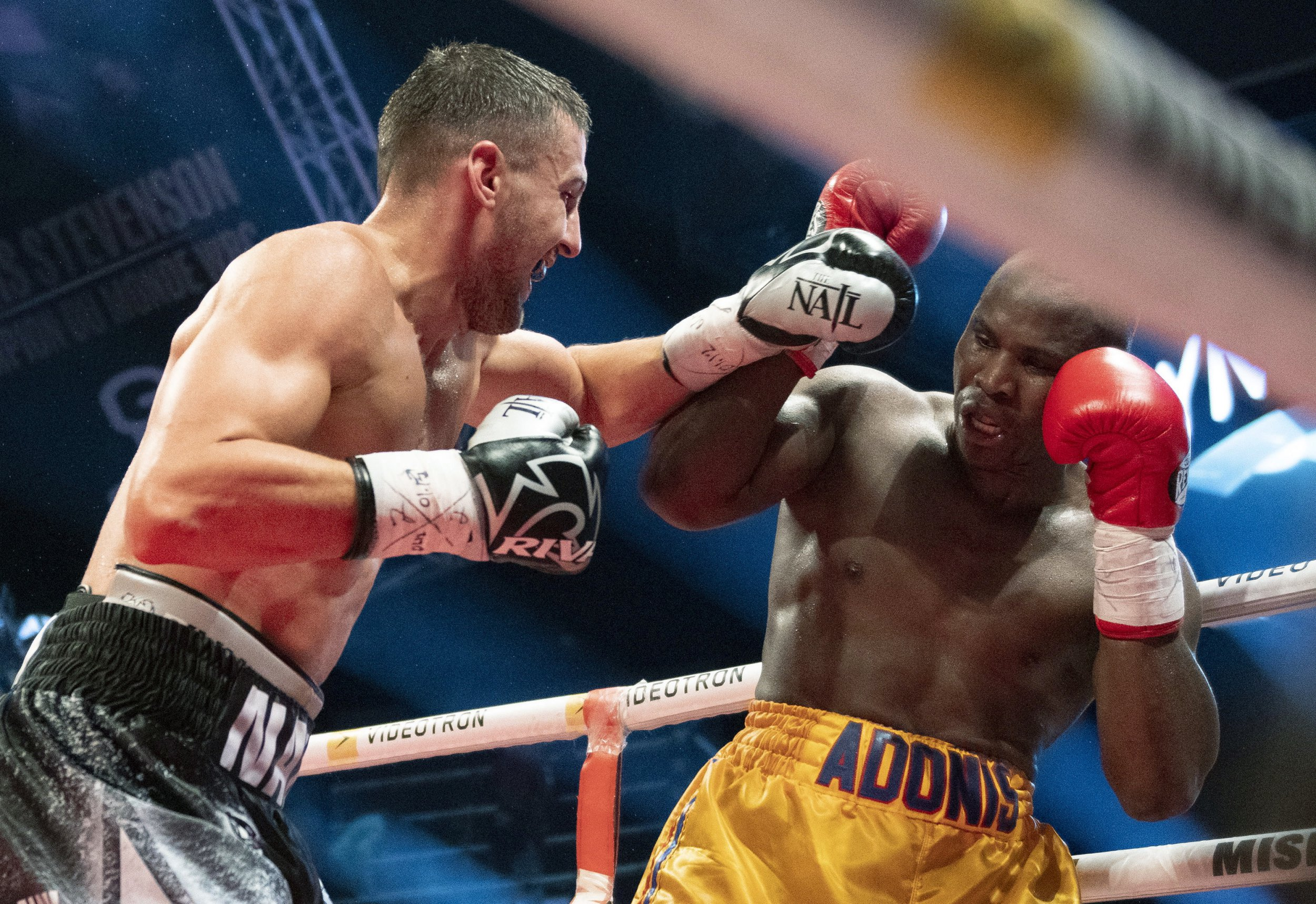 Oleksandr Gvozdyk, of Ukraine, forces Adonis Stevenson, of Canada, in the corner during their light heavyweight WBC championship boxing fight, Saturday, Dec. 1, 2018, in Quebec City. (Jacques Boissinot/The Canadian Press via AP)