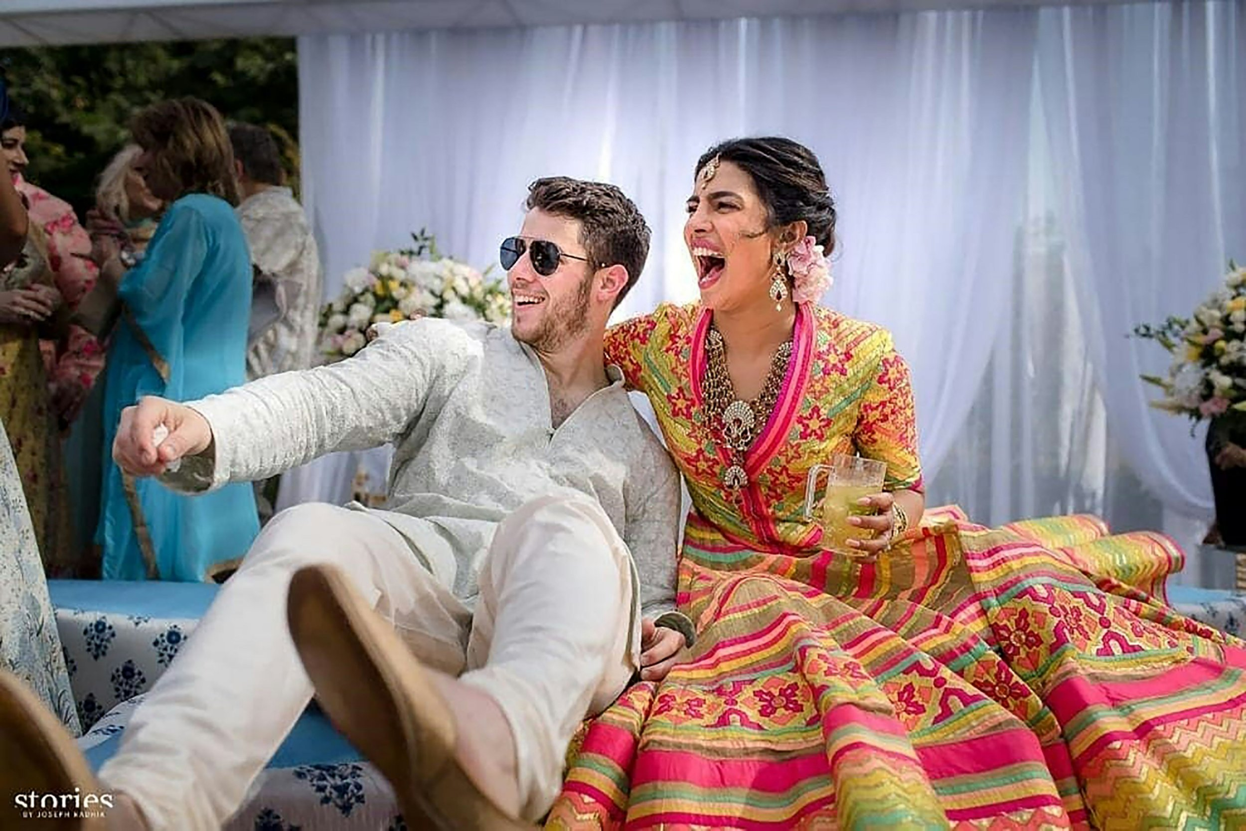 "This handout photo released by Raindrop Media on December 1, 2018, shows Bollywood actress Priyanka Chopra (R) and American singer Nick Jonas during their wedding celebration at Umaid Bhawan palace in Jodhpur. - Bollywood actress Priyanka Chopra and American singer Nick Jonas have tied the knot at a lavish ceremony in a royal Indian palace before friends and family. Fireworks lit up the sky as the celebrity couple exchanged vows on December 1 in a Christian ceremony at the opulent Umaid Bhawan palace in Jodhpur, in the western desert state of Rajasthan. (Photo by Handout / RAINDROP MEDIA / AFP) / RESTRICTED TO EDITORIAL USE - MANDATORY CREDIT ""AFP PHOTO / RAINDROP MEDIA"" - NO MARKETING NO ADVERTISING CAMPAIGNS - DISTRIBUTED AS A SERVICE TO CLIENTSHANDOUT/AFP/Getty Images"