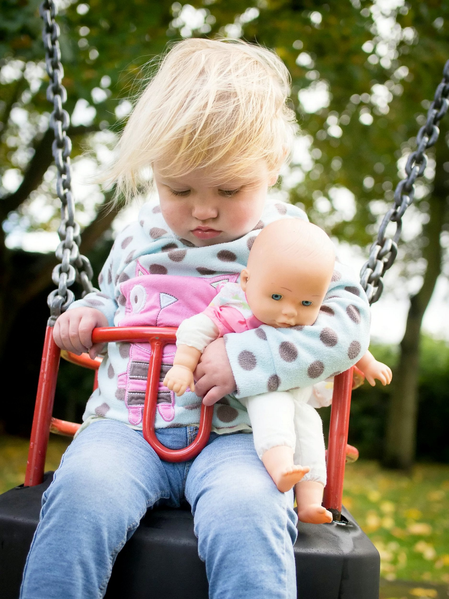 A dad snapped a cute photo of his toddler falling asleep in her swing (PICTURED) - not realising that her tiredness was a symptom of undiagnosed cancer. See SWNS story SWMDcancer. Dave Fletcher took the picture of his daughter Izzy when she was 23 months old - just a few weeks before she was given the shock diagnosis of leukaemia. Dave and wife Vicky, from Claines, Worcs., took Izzy to the GP in January 2017 when she came out in a strange rash on her leg. They were advised to come back several days later for blood tests if the rash had not gone, and to take her straight to hospital if it got worse. But by the next morning, Izzy?s rash had spread and she then developed a temperature, so her parents took her to Worcester Royal Hospital. Here, she was diagnosed with leukaemia the same day.
