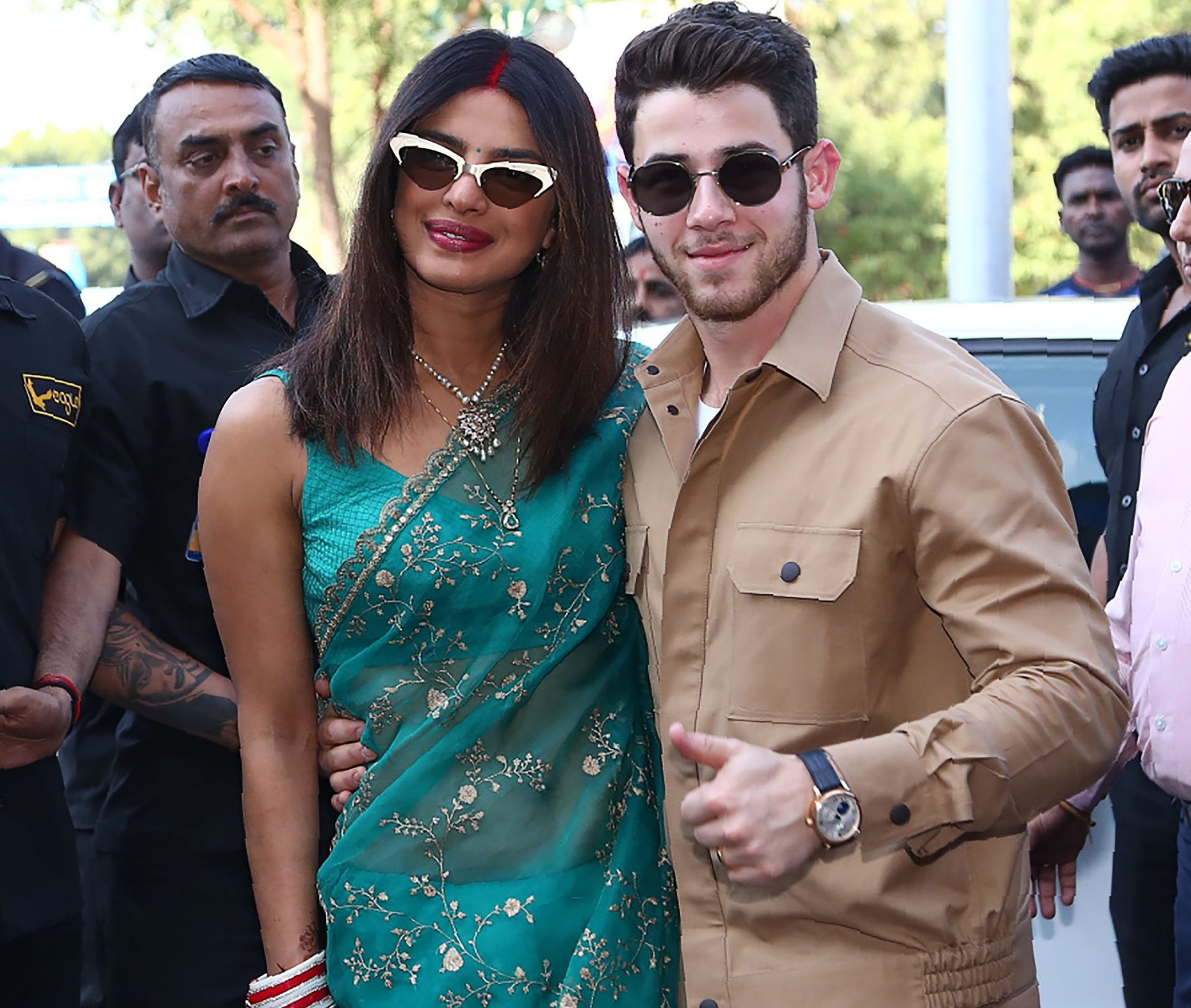 Indian Bollywood actress Priyanka Chopra (C) and US musician Nick Jonas (centre R) pose for a photograph as they leave after their wedding ceremony in Jodhpur in the western Indian state of Rajasthan on December 3, 2018. - Bollywood actress Priyanka Chopra and American singer Nick Jonas hosted an extravagant concert on December 2 for their star-studded wedding guests as the couple tied the knot at a lavish Indian palace. (Photo by - / AFP)-/AFP/Getty Images