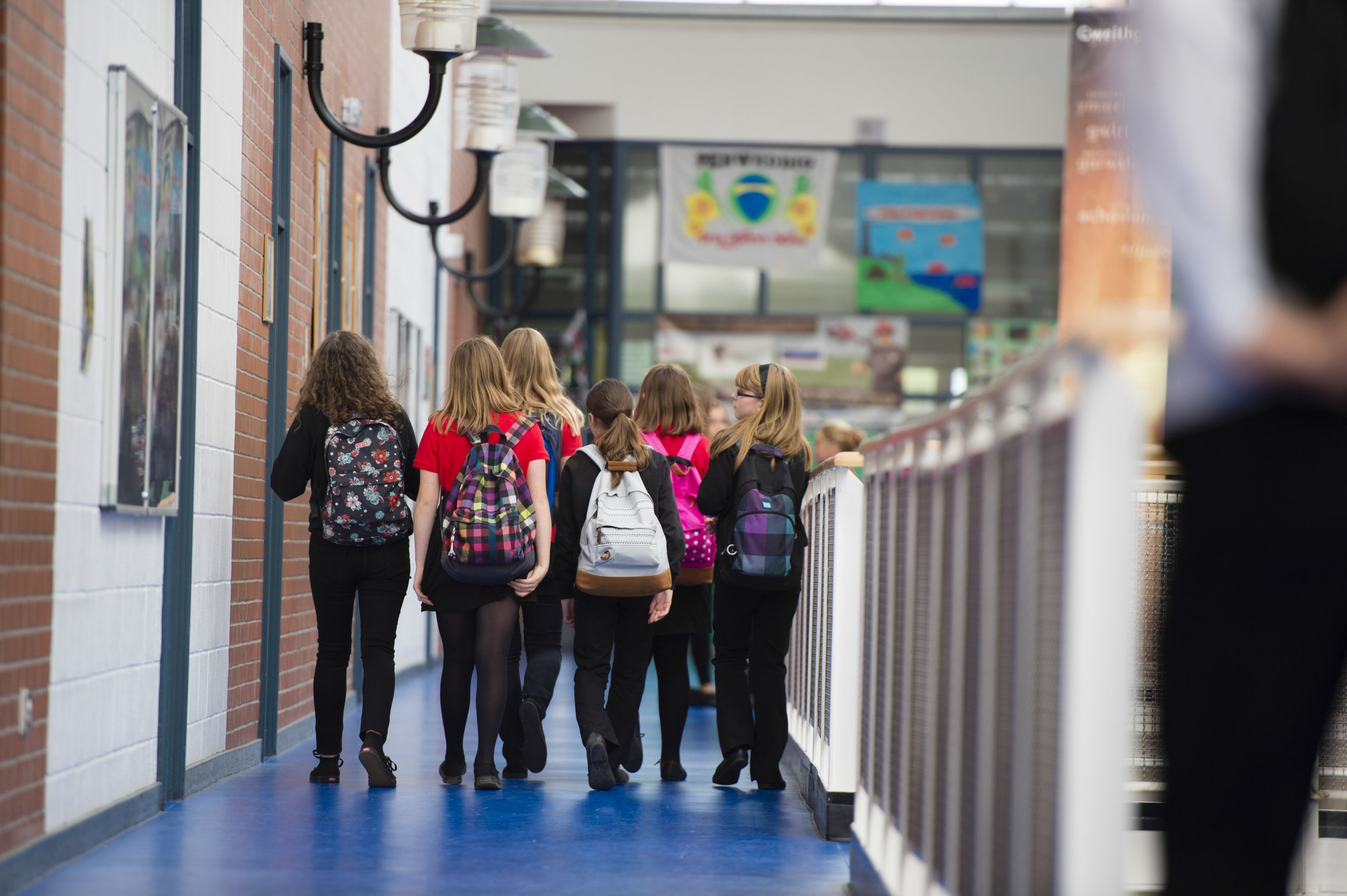 Secondary education Wales UK: rear view of girl pupils walking to classes lessons (Photo by: Photofusion/UIG via Getty Images)