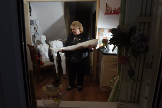 Pics by Caters News - (PICTURED: Maureen Wall at home with some of the limbs from her mannequins that caused the mix up with the Police.) A retired church volunteer was left red-faced when police became concerned she was DISMEMBERING BODIES at home when she was in fact using life-sized mannequins to create a religious nativity display.Pensioner Maureen Wall, 71, was shocked when she was forced to answer uncomfortable questions from an officer on her doorstep in Bulwell, Nottingham, when cops spotted the bizarre plastic limbs in her home.The former foster carer spent four months painstakingly putting together the display for St John the Divine Church in Bulwell after buying the seven life-sized mannequins for 30 each. - SEE CATERS COPY