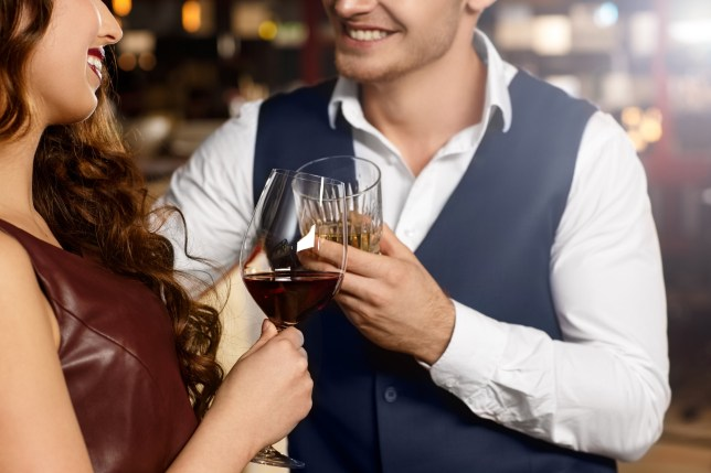 Matchmaking. Cropped shot of a happy couple having drinks at the bar smiling joyfully; Shutterstock ID 473780596; Purchase Order: -