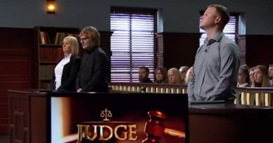 Two members of the public stand up in Judge Rinder's courtroom
