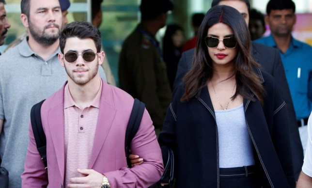 Actress Priyanka Chopra and her husband Nick Jonas arrive in Udaipur to attend pre-wedding celebrations of Isha Ambani, daughter of the Chairman of Reliance Industries Mukesh Ambani, in the desert state of Rajasthan, India, December 8, 2018. REUTERS/Amit Dave