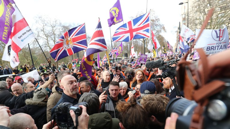 "Tommy Robinson (centre, holding mobile phone) arrives to take part in a ""Brexit Betrayal"" march and rally organised by Ukip in central London. PRESS ASSOCIATION Photo. Picture date: Sunday December 9, 2018. See PA story POLITICS Brexit March. Photo credit should read: Gareth Fuller/PA Wire"