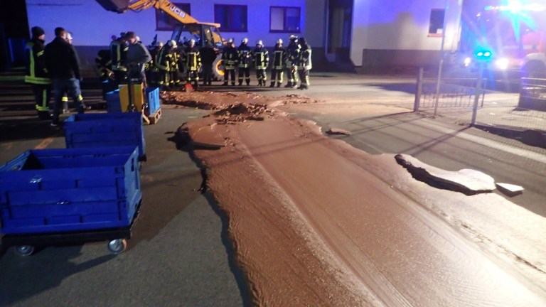 Spilt chocolate is seen on a road in Werl, Germany December 10, 2018 in this picture obtained from social media. Picture taken December 10, 2018. FEUERWEHR WERL/via REUTERS THIS IMAGE HAS BEEN SUPPLIED BY A THIRD PARTY. MANDATORY CREDIT. NO RESALES. NO ARCHIVES.