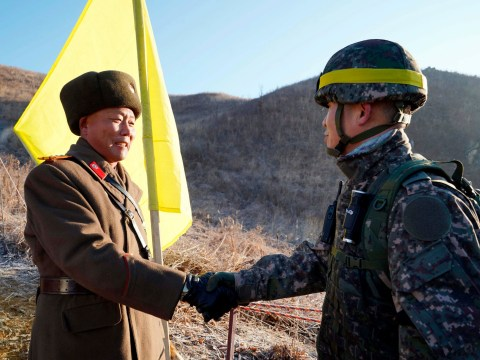 Historic moment soldiers from North and South Korea shake hands over border
