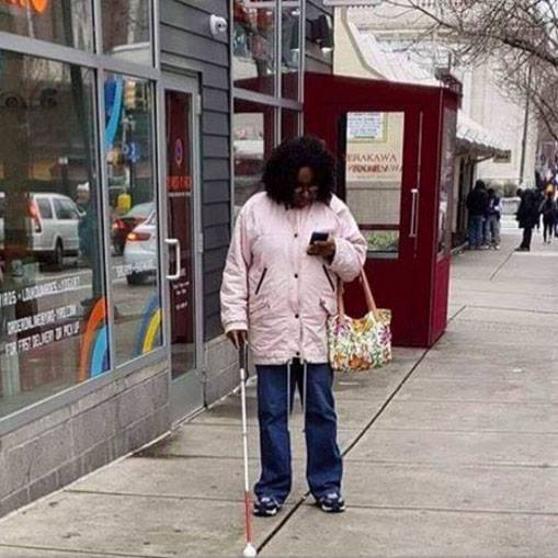Using my phone and cane at the same time doesn't mean I'm faking blindness